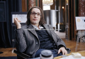 """movie, """"99 francs"""", director: Jan Kounen, scene with: Jean Dujardin, comedy, novel by Frederic Beigbeder, sitting, glasses Copyright NG Collection/Interfoto/Writer Pictures contact +44 (0)20 822 41564 sales@writerpictures.com www.writerpictures.com"""